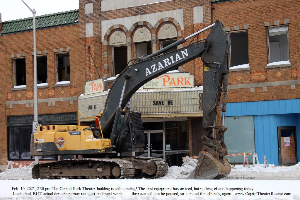 Photograph of backhoe parked in front of the Capitol-Park Theater